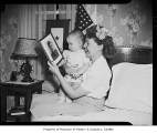 Violet Wolff showing baby photo of soldier husband on Father's Day, Seattle, 1941