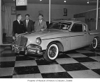 1961 Studebaker Hawk and salesmen in the showroom, probably in Seattle, 1961