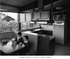 Kane residence interior showing kitchen and children at the breakfast nook, Seattle, 1965