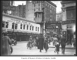 Pedestrians on downtown street, Seattle, ca. 1925