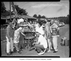 Fourth of July party on NW 120th Street showing people around a barbeque, Seattle, 1961