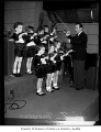 Orchestra leader Vic Meyers with young musicians, probably in Seattle, 1934