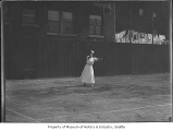 Woman playing tennis, probably in Seattle, ca. 1910