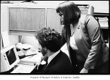 Man and woman working at computer in office, probably in Seattle, March 20, 1987