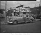 Farwest Taxi outside dispatch building, Seattle, 1947