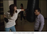 Woman and man with punching bag at Hillman City Boxing Gym, Seattle, ca. 1985