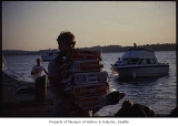 Boater with cases of beer on Lake Washington, ca. 1985