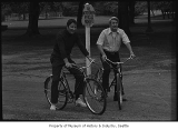 John Spellman and Wes Uhlman on bikes at Green Lake, Seattle, 1971