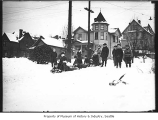 Children sledding on residential street, Seattle, ca. 1920