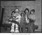 Children and clowns at Shrine Circus, Seattle, ca. 1940