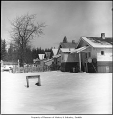 Residential street in snow, Selleck, 1971