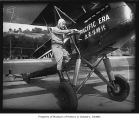 Robert B. Wark with his biplane, ca. 1930