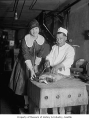 Chef Gus Paccos and unidentified woman, Seattle, 1927