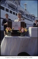 Woman speaking at cruise ship sailing party, Seattle, July 1, 1986
