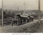 Trucks hauling water pipe, Seattle, November 8, 1922