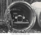 Engineer Frank Cook with large water pipe, Landsburg, February 21, 1930