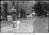 Joggers with dogs in park, probably in Seattle, April 11, 1987