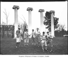 Students in front of columns on University of Washington campus, Seattle, ca. 1925