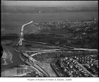 Aerial of Evergreen Point Bridge under construction from west, Seattle, 1963