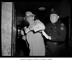 Roy Atkinson in police custody at Communist hearings, probably in Seattle, 1955