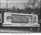 Carnation Milk billboard, Seattle, 1944