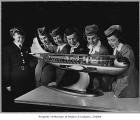 Flight attendants with model of Boeing Stratocruiser, Seattle, n.d.