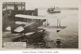 Gorst Air Transport seaplane with ferry in background, Seattle, ca. 1933