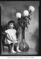 Child with dahlias, Seattle, 1936