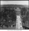 Aerial of east end of Evergreen Point Bridge under construction from west, Seattle, 1963