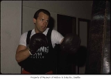 Man with punching bag at Hillman City Boxing Gym, Seattle, ca. 1985