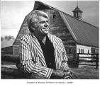 Jack Barron standing in front of barn, 1978