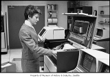 Woman loading printer in computer room, probably in Seattle, November 1, 1986