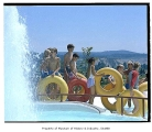 Children with inner tubes at water slide, Issaquah, July 10, 1985