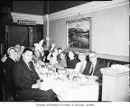 Von's Rabbit seated at a table with diners, probably in Seattle, March 29, 1959