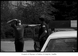 Policeman supervising sobriety test, Issaquah, ca. 1985