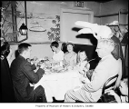 Von's Rabbit approaching a table at which diners are seated, probably in Seattle, March 29, 1959