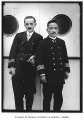 Captain D. Fuchigami and another man on board ship, Seattle, ca. 1925
