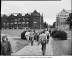 People on the walkway in the quad and between Miller and Smith Halls, University of Washington,...