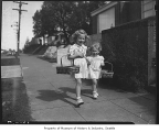 Elizabeth and Patricia Danz with Easter baskets, Seattle, March 22, 1948