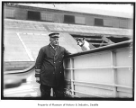 Captain N.E. Cousins with dog, Seattle, n.d.