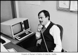 Man on phone in office, probably in Seattle, February 1, 1987