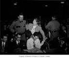 Florence James ejected from the Canwell Committee hearings, 1948