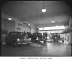 Studebakers in showroom, Seattle, 1940