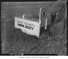 Animal in King County Humane Society trap, Seattle, 1939