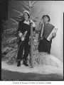 Evelyn Curtiss and Zac Kalbach posing in winter scene, Seattle, 1938