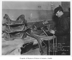 Worker making saddle at Duncan & Sons, Seattle, December 23, 1918