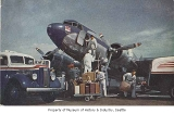 Workers loading luggage onto United Mainliner, n.d.