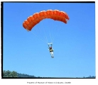 Skydiver with parachute, Issaquah, July 10, 1985