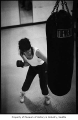 Woman with punching bag, probably in Seattle, March 21, 1987