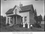 Family in front of their house, probably in Seattle, ca. 1910